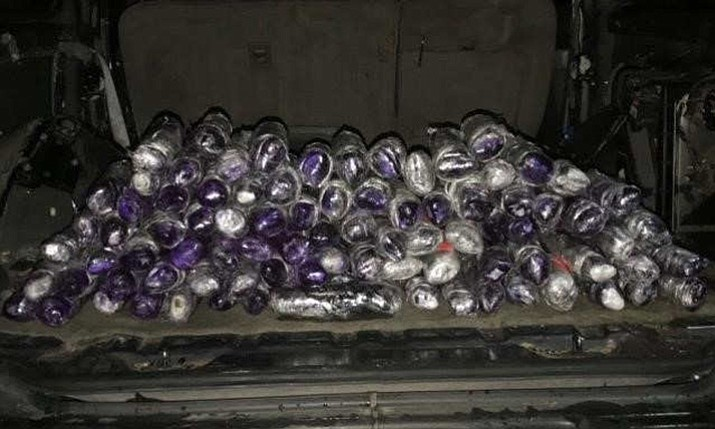 Border authorities in Arizona say they arrested six people Friday involved in attempts to smuggle more than 200 pounds of methamphetamine and cocaine into the United States. Pictured above, officers seized 96 pounds of meth hidden throughout one of the drug smuggling vehicles. (U.S. Customs and Border Protection)