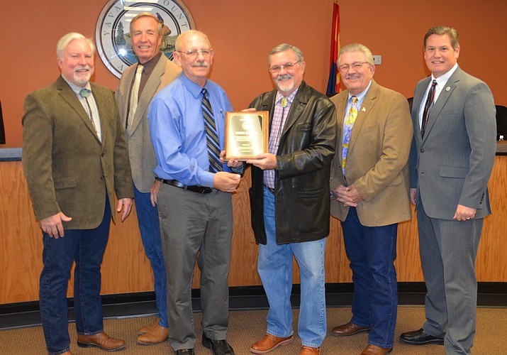 Byron Jaspers was presented with a plaque from the Board of Supervisors, in recognition and appreciation for 23 Years of Dedicated Service to the Citizens of Yavapai County. (Photo courtesy of Yavapai County Board of Supervisors)