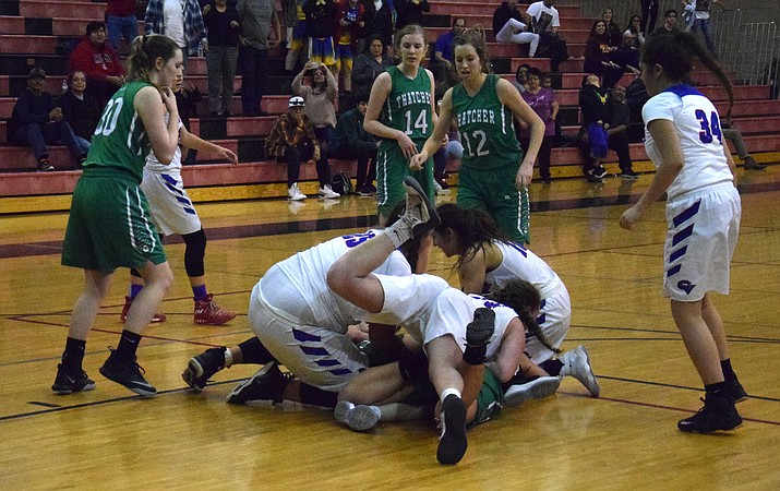 Camp Verde and Thatcher battle for a loose ball at the end of regulation during the Cowboys' 48-47 overtime loss to the Eagles during the first round of the state tournament at Bradshaw Mountain.  (VVN/James Kelley)