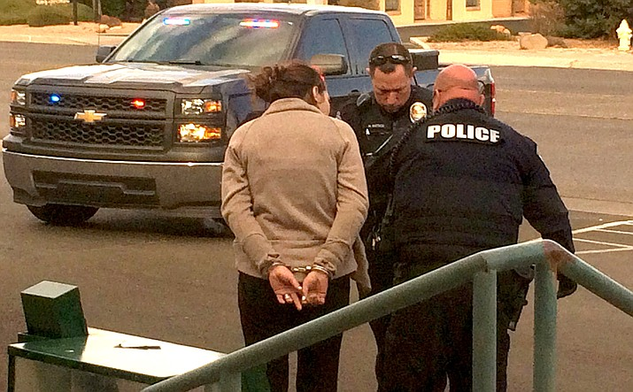 Police arrest Rochelle Watkins at the 100 block of  South Main Street in Cottonwood. (VVN/Vyto Starinskas)