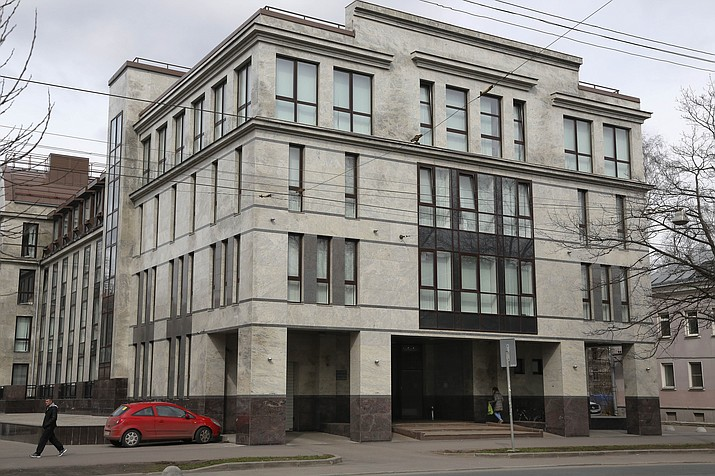"In this file photo taken on Sunday, April 19, 2015, a women enters the four-storey building known as the ""troll factory"" in St. Petersburg, Russia. The U.S. government allege the Internet Research Agency started interfering as early as 2014 in U.S. politics, extending to the 2016 presidential election, saying the agency was funded by a St. Petersburg businessman Yevgeny Prigozhin. (AP Photo/Dmitry Lovetsky, File)"