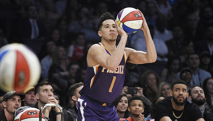 Suns' Devin Booker  walks off with 3-point title