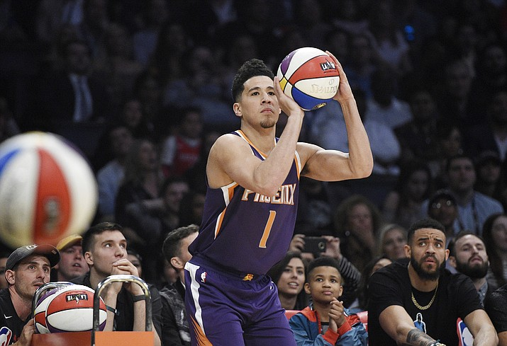 Phoenix Suns' Devin Booker shoots during the NBA basketball All-Star weekend 3-point contest Saturday, Feb. 17, 2018, in Los Angeles. Booker won the event. (Chris Pizzello/AP)