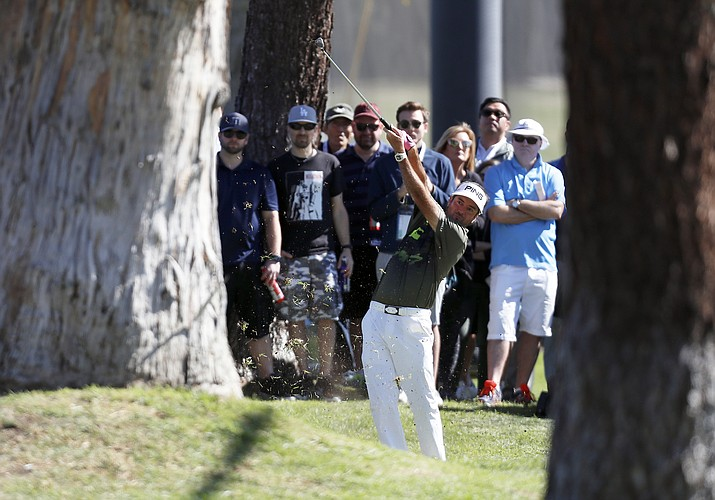 Bubba Watson hits his second shot on the second hole during the third round of the Genesis Open golf tournament at Riviera Country Club Saturday, Feb. 17, 2018, in the Pacific Palisades area of Los Angeles. (Ryan Kang/AP)