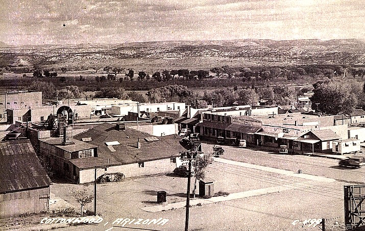 """Left front, W. Jess Siler Warehouse (rebuilt as Tavern Hotel); Left Center, """"Siler Store"""" and the roof of the south part of the 1917 Bungalow, with Bessie Siler's laundry and dry cleaning in back and the long """"feed and seed"""" addition along the south side. The Chokree Gobins Building across the street has the words """"Verde Valley Distributing Co."""" across the front."""