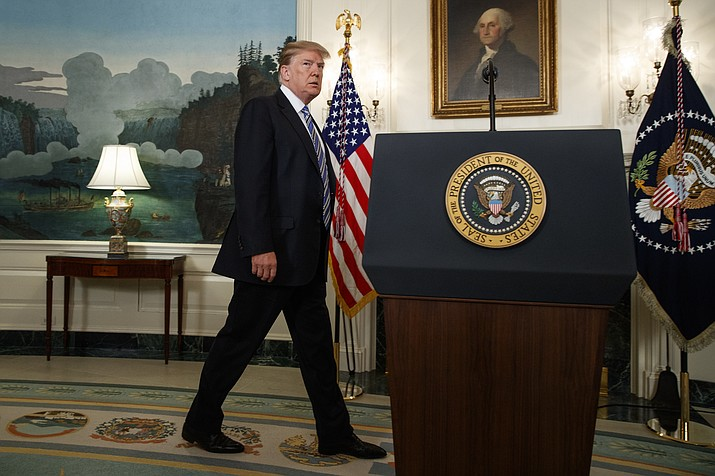 President Donald Trump arrives to deliver a statement on the mass shooting at a South Florida High School from the White House, Thursday, Feb. 15, 2018, in Washington. (AP Photo/Evan Vucci)