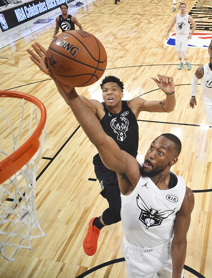 Team Stephen's Giannis Antetokounmpo, left, of the Milwaukee Bucks, blocks the shot of Team LeBron's Kemba Walker, of the Charlotte Hornets, during the first half of an NBA All-Star basketball game, Sunday, Feb. 18, 2018, in Los Angeles.