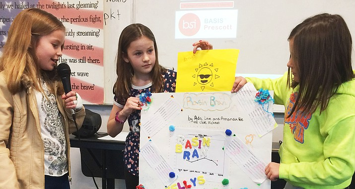 From left, fourth-graders Amanda Fee, Claire Hickman and Ada Love give their presentation on Raisin Bran.