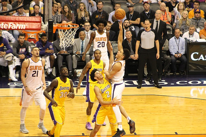 Devin Booker puts up a shot against the Lakers earlier this season. Booker won the 3-point shooting championship over the All-Star weekend.