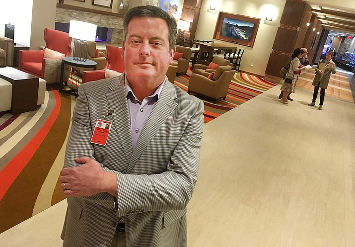 "Cliff Castle Casino's new six-story 122-room hotel is now finished and ready for Friday's official grand opening. ""Cutting the ribbon, getting the hotel open"" will make the day a success,"" says James Perry, the Casino's Director of Marketing. (Photo by Bill Helm)"
