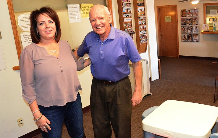 Dr. Robert Jochim, MD, and one of his daughters, Cathleen Jochim-Malapanes, MSN FNP-BC, pose in their combined waiting room in Cottonwood. Dr. Jochim opened a practice in Cottonwood in 1972, but not many doctors are following in his footsteps today. VVN/Vyto Starinskas