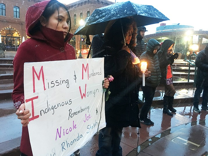 Nicole Joe's mother, Rosemary Begay, (right) holds a candle at a vigil held Feb. 14 in Flagstaff. The vigil also called attention to other Native women who are missing or who have been murdered. (Katherine Locke/NHO)