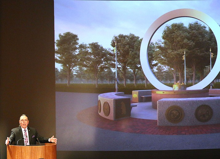"""Harvey Pratt talks about his design, """"Warriors Circle of Honor,"""" one of the five finalists for the National Native American Veterans Memorial that was presented at the National Museum of the American Indian. (Photo by Philip Athey/Cronkite News)"""