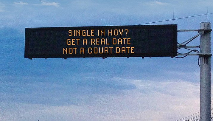"Winning messages in ADOT's safety message contest last year included one from Jim Atkinson: ""Single in HOV? / Get a real date / not a court date.'' The contest is being hosted again this year. (Courier illustration)"