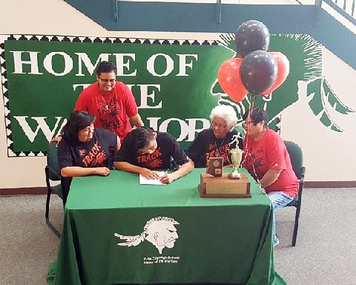 Tristan Antonio,18, a senior at Tuba City High School signed a full ride scholarship to Bacone College in Muskogee, Oklahoma to run Cross Country starting August 2018. Antonio's family members were present for his signing. (Rosanda Suetopka/NHO)
