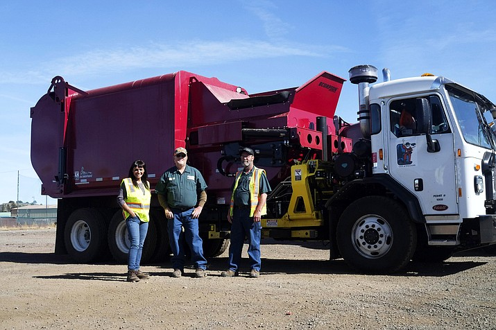 Williams Sanitation Department employees Cindy Holmes, Jeff Pettit and James 'Jimy' Mac stand next to a new garbage truck recently purchased by the city of Williams. (Loretta Yerian/WGCN)