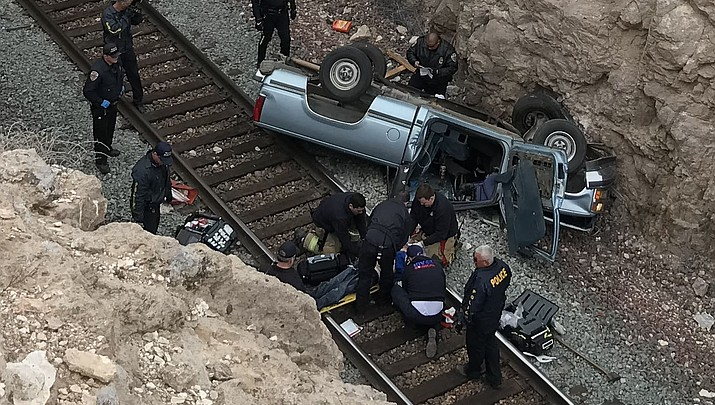 *** UPDATED *** Truck crashes, falls onto train tracks off of Hualapai Mountain Road