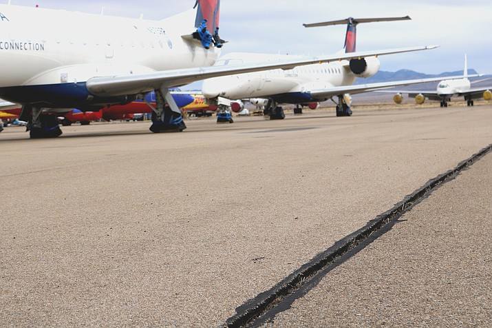 The routine-maintenance filling of cracks was scheduled to begin Monday, but was postponed due to weather.