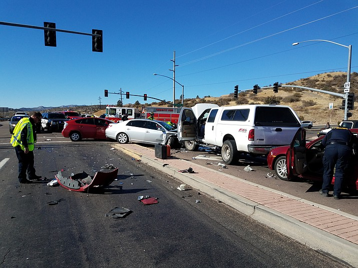 Emergency personnel work the scene of the four-vehicle collision Tuesday. (Prescott Fire/Courtesy photos)