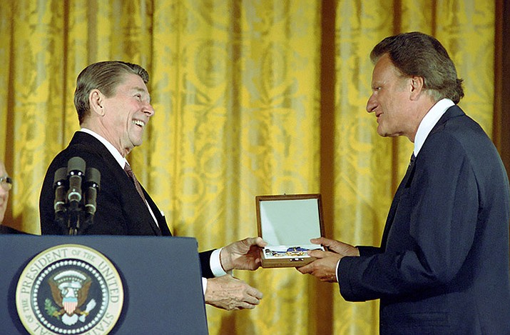 President Ronald Reagan presented Billy Graham the Presidential Medal of Freedom in 1983.