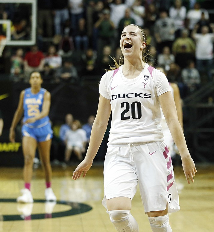 Oregon guard Sabrina Ionescu celebrates in the last minutes of their Pac-12 NCAA college basketball game in Eugene, Ore., Monday, Feb. 19, 2018. Oregon won, 101-94 in overtime.