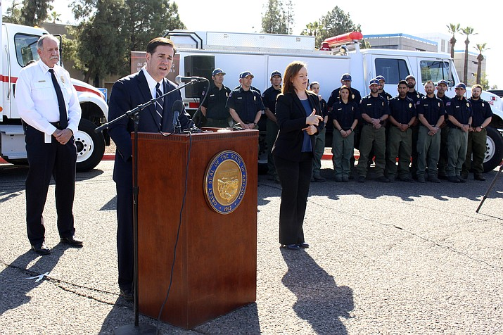 Arizona Gov. Doug Ducey speaks at a news conference on wildfire season as state Forester Jeff Whitney and fire crews look on Thursday, Feb. 22, 2018 in Phoenix, Ariz. Whitney said the upcoming fire season could be one of the worst in his 45 years in firefighting because of the lack of rain across the state's grasslands, chaparral and pine forests. (AP photo)