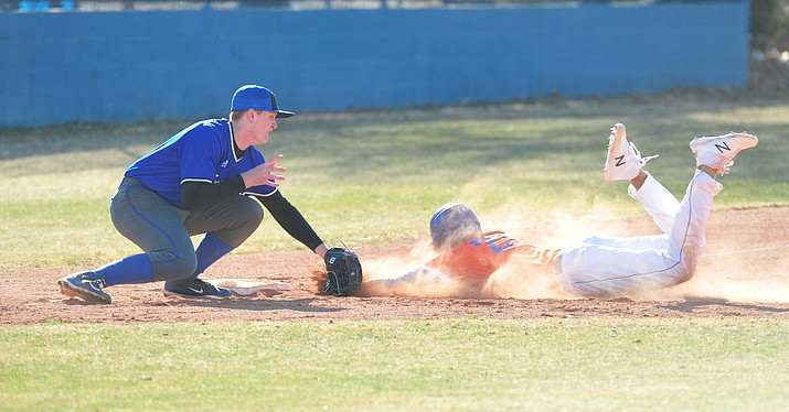 Chino Valley's Abdiel Sanchez gets thrown out at third as the Cougars play the Snowflake Lobos to open the 2018 baseball season Thursday afternoon in Chino Valley. (Les Stukenberg/Courier)