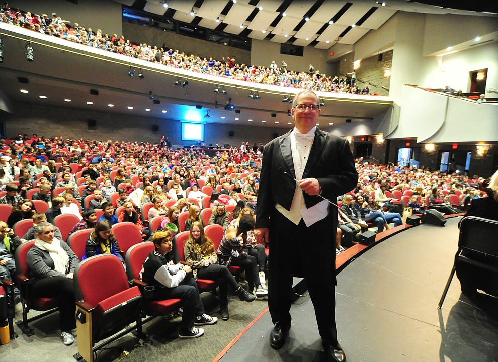 Conductor Joseph Place before the Prescott Pops Symphony performs for 2200 third to fifth grade students from around Yavapai County in the annual Music Memory Concert at the Yavapai College Performance Hall Thursday morning. (Les Stukenberg/Courier)