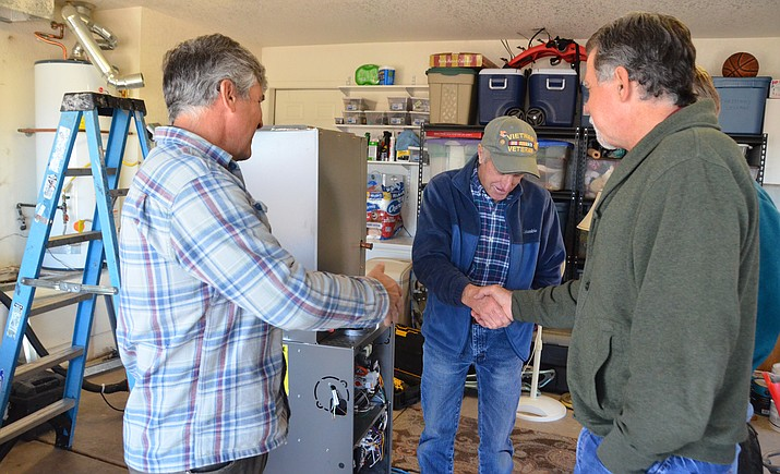 Adam and Ted Goettl, owners of Goettl's High Desert Mechanical in the Verde Valley since 1987, and their crew were installing a new heating and air conditioning system at veteran Bill Irving's house in Clarkdale Tuesday. (VVN/Vyto Starinskas)