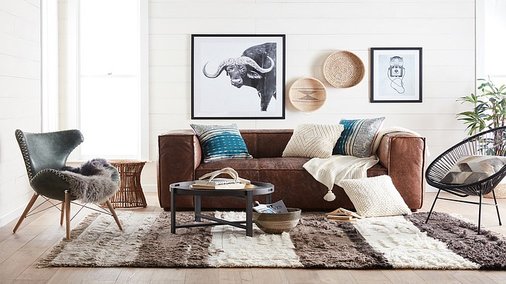 This undated artist rending shows Walmart's  Bohemian-style living room, part of Walmart's new online home shopping experience that will let shoppers find items based on their preferred style. The plan, announced Thursday, Feb. 22, is a first glimpse of Walmart's efforts to redesign its website with a focus on fashion and home furnishing. (Walmart via AP)