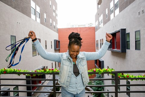 June holds up keys to her home at New Pershing apartments in downtown Los Angeles. (Michael Brannigan/Business Wire)