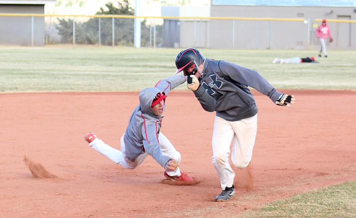 Mingus senior Andrew Kulis dives to tag out sophomore Chris Mathe during practice on Friday afternoon. Kulis earned the win as a pitcher in the Marauders' season opening 15-4 victory at Combs and hit two triples. (VVN/James Kelley)