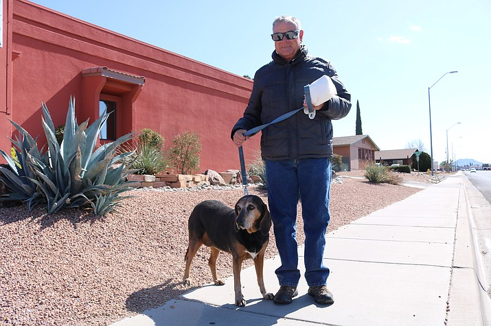 Kingman resident Robert Laulo takes Lola, 9, for a walk Thursday, National Walk Your Dog Day.