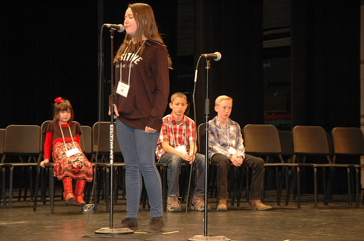 Makayla Boyd, an eighth grader at Bradshaw Mountain Middle School, steps up to the microphone at the 72nd annual Yavapai County Spelling Bee on Saturday, Feb. 24, 2018, in Prescott. Boyd won the spelling bee, and will now face 26 other students from across the state in March at the Arizona Spelling Bee. (Jason Wheeler/Courier)