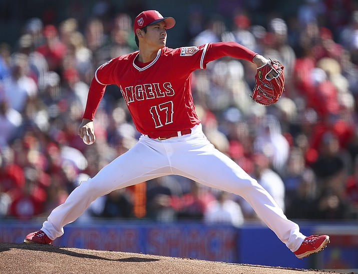 Los Angeles Angels' Shohei Ohtani works against the Milwaukee Brewers during the first inning of a spring training baseball game on Saturday, Feb. 24, 2018, in Tempe. (Ben Margot/AP)