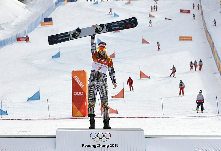 Gold medal winner Ester Ledecka, of the Czech Republic, celebrates after the women's parallel giant slalom at Phoenix Snow Park at the 2018 Winter Olympics in Pyeongchang, South Korea, on Saturday, Feb. 24, 2018. (Lee Jin-man/AP)