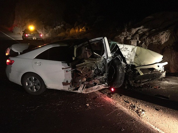 A white sedan sits on Highway 89 at the Granite Dells after it rolled when a 46-year-old man fell asleep at the wheel Sunday, Feb. 25, 2018, in Prescott. (Prescott Fire/Courtesy)