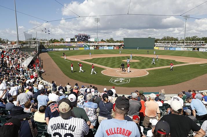 Spectators stand for Minnesota Twins' Mitch Garver after his two-run home run in the fourth inning of a spring training baseball game against the Tampa Bay Rays, Sunday, Feb. 25, 2018, in Fort Myers, Fla. (John Minchillo/AP)