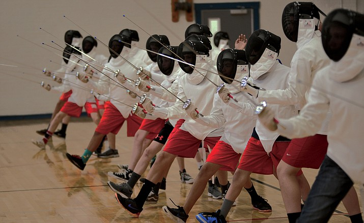 Boys warm up during Ian Owens' popular fencing class at Prescott Mile High Middle School Tuesday afternoon. The girls' fencing class is taught in the mornings. (Les Stukenberg/Courier)