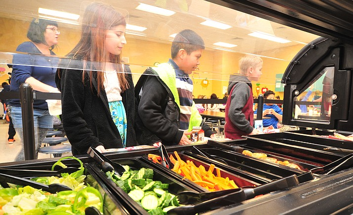 Fruits and vegetables to choose from at lunchtime at Coyote Springs Elementary School in Prescott Valley. (Les Stukenberg/Courier)