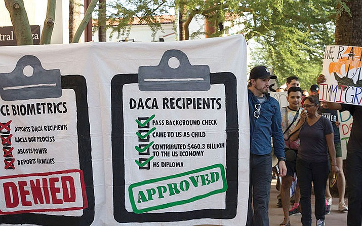 Protesters march outside of the ICE building against a potential repeal of the DACA program.
