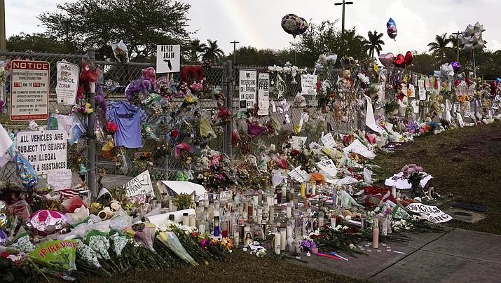 A  memorial outside of Marjory Stoneman Douglas High School in Parkland Fla., Monday, Feb. 26, 2018. (Joe Cavaretta /South Florida Sun-Sentinel via AP)