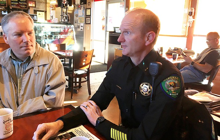Camp Verde Town Manager Russ Martin, left, listens, as Commander Brian Armstrong of the Camp Verde Marshal's Office talks during the monthly Coffee With a Cop, Monday at Thanks a Latte. (Photo by Bill Helm)