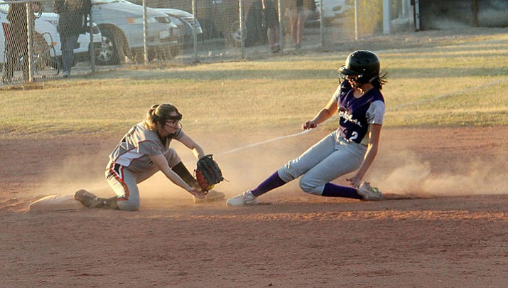 Lee Williams' Kara Mertens attempts to tag out a Lake Havasu runner Monday night. The Lady Vols dropped a 15-13 loss despite Courtney Janney's two home runs.