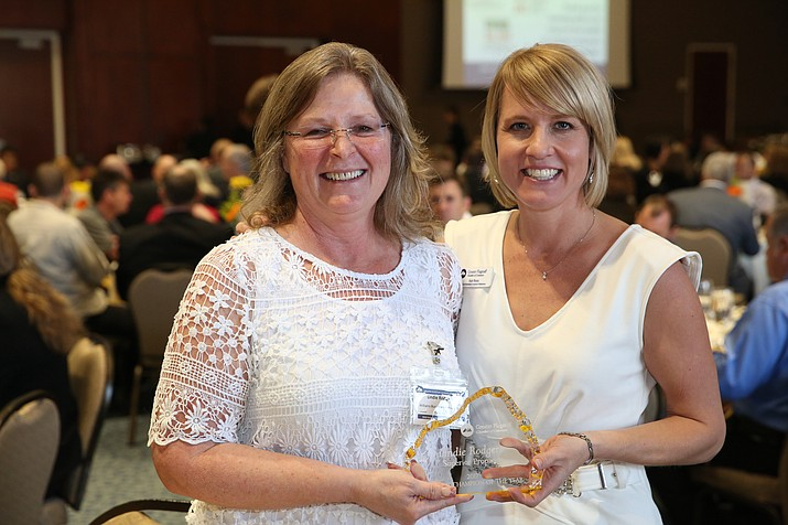 Lindie Rodgers (left) was presented the 2017 Chamber Champion of the Year award by the Greater Flagstaff Chamber. Kat Ross, vice president of Investor Relations with the Flagstaff Chamber, stands with Rodgers at the ATHENA Awards ceremony in Flagstaff Feb. 9. (Submitted photo)