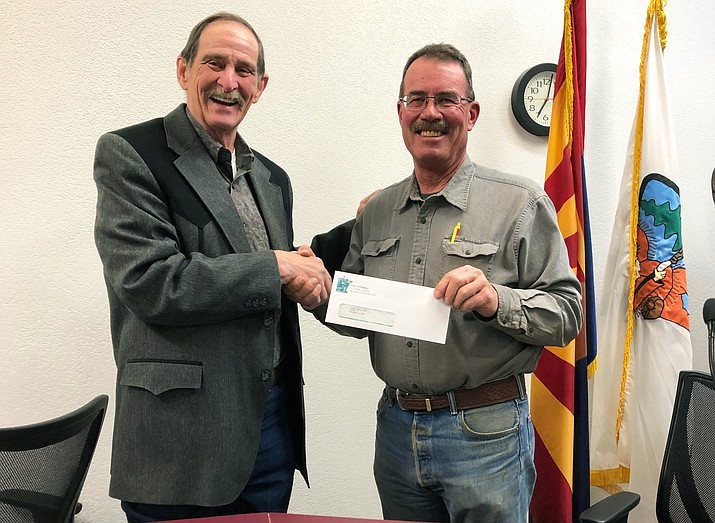 Mayor John Moore presents a $1,500 check from the city of Williams to Parents Who Care member Frank McNelly. The money will be used toward a graduation night shut-in party. (Wendy Howell/WGCN)