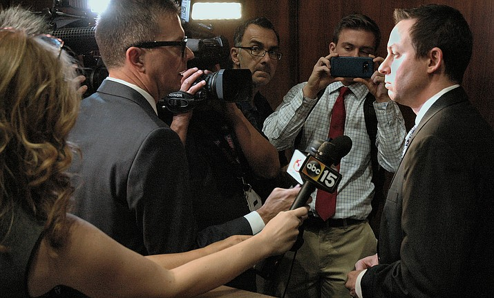 House Speaker J.D. Mesnard, at right, meets with members of the news media in Phoenix. (Capitol Media Services, file photo)