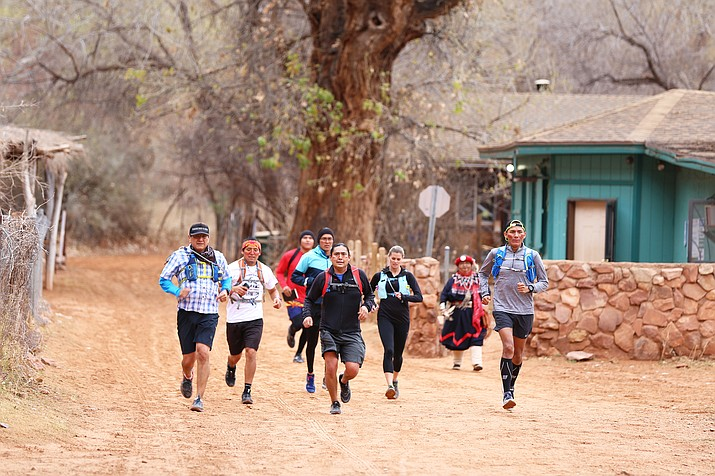 Runners make their way into the village of Supai. Photo courtesy of Christopher Cadeau, (The Walter Cronkite School of Journalism and Mass Communication)