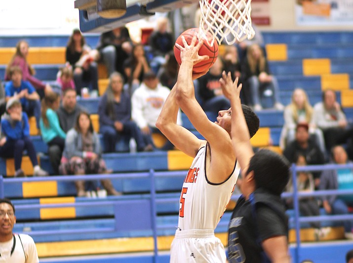 Zack Perkins lays up a shot in the Vikings game with Baboquivari Feb. 16  (Erin Ford,WGCN)