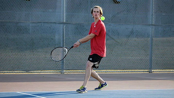 Lee Williams' Jordon Freeman won his match by scores of 6-2, 6-1 Wednesday against Kingman High's Xeth Walker.